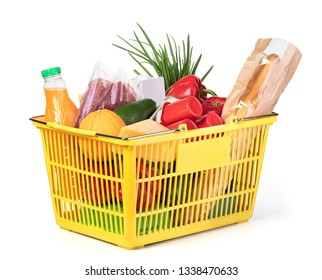 Plastic shopping basket with of grocery products isolated on white