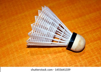 Plastic Shuttlecock on colorful wood