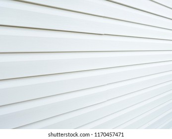 Plastic siding surface in black and white. Abstract background and texture.