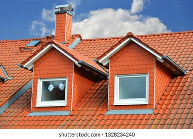 With Plastic Slate plated Dormer Windows and Chimney on a red tiled Roof