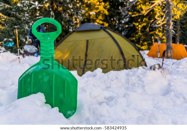 plastic sledge in front of a tent in winter