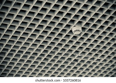 Plastic smoke detector isolated object with unique background photograph