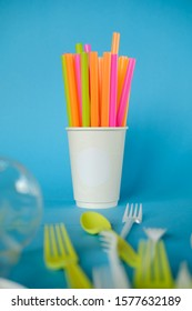 Plastic spoons, forks, straws and cup, Single use, Disposable tableware, Plastic pollution, waste, eco, ecology, recycle. Plastic processing problem