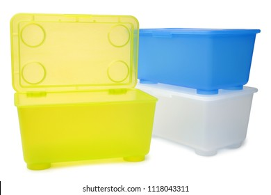 Plastic storage boxes on white background