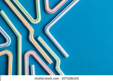Plastic straws on a blue background