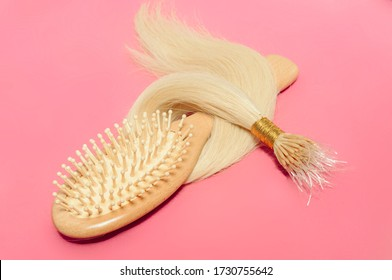 Plastic string (Silicone line)tip straight blonde human hair extensions along with a wooden comb