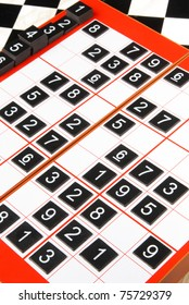 Plastic sudoku board and tiles