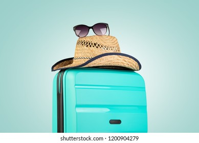 Plastic suitcase with hat and sunglasses