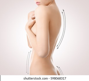 Plastic surgery concept. Female body with marks on light background