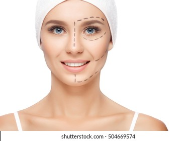 Plastic surgery woman face. Young woman with perforation lines on her face before plastic surgery operation. Beautician touch and draw correction lines on woman face. Isolated