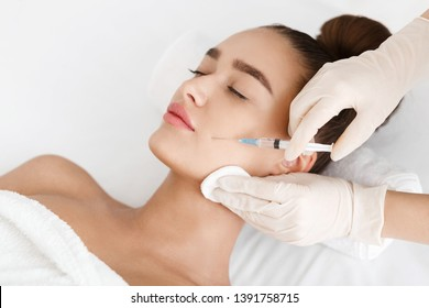 Plastic Surgery. Young Woman Receiving Botox Injection In Beauty Clinic