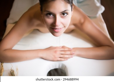 Plastic surgery,liposuction and cellulite removal concept.Spa woman wrapped in towels.Skincare.Perfect young exfoliated skin.Woman having body massage happy with the beauty treatment results