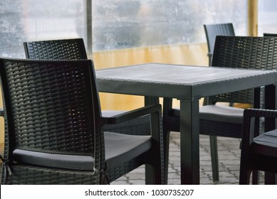 Plastic table and chairs in the yard of a small cafe bar
