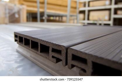 Plastic terrace board lies on the floor