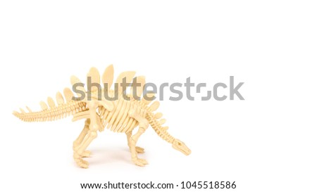 Plastic Toy Animal Dinosaur Skeleton Isolated On White Background Copy Space Template