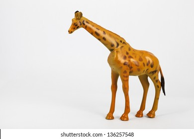 plastic toy animals giraffe and elephant with white background