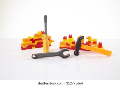 Plastic toy blocks with toy construction tools