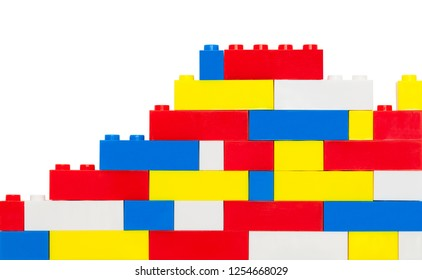 Plastic Toy Brick Wall Isolated on a White Background.