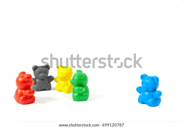 Plastic toy figures in the colors of the major political parties in Germany (AfD clearly isolated off to the side) on white background