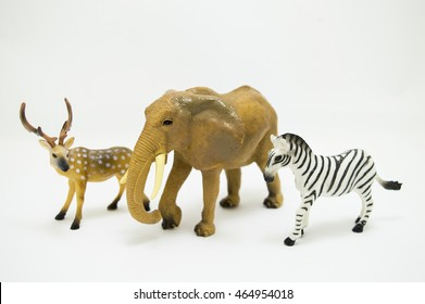 Plastic toy figurines on a white background