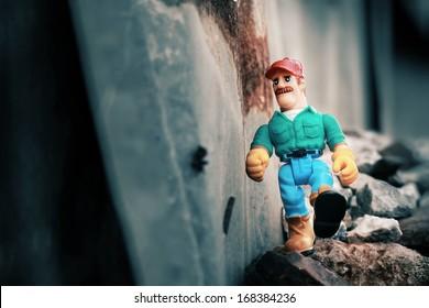 Plastic toy figurines as the repairman.