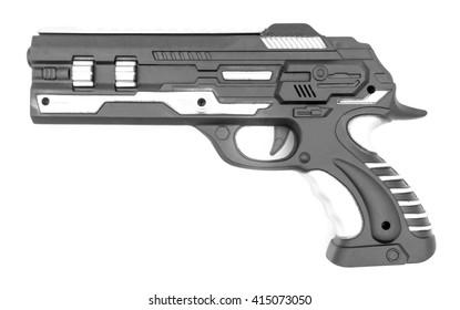 Plastic toy gun on white
