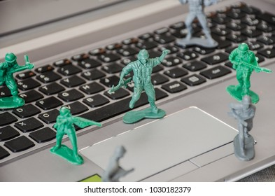 Plastic toy soldiers defend a computer from hacker attacks