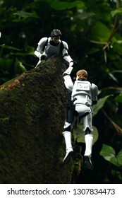 Plastic Toys in the jungle young Han Solo and Luke Skywalker disquised