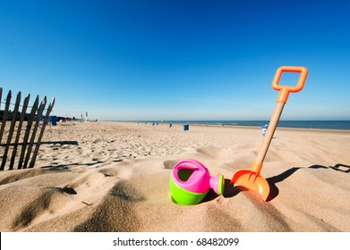Plastic toys in the sand at the empty beach