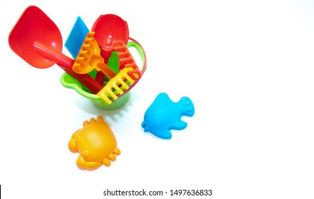 Plastic toys for sand isolated on white background. Kids toys.