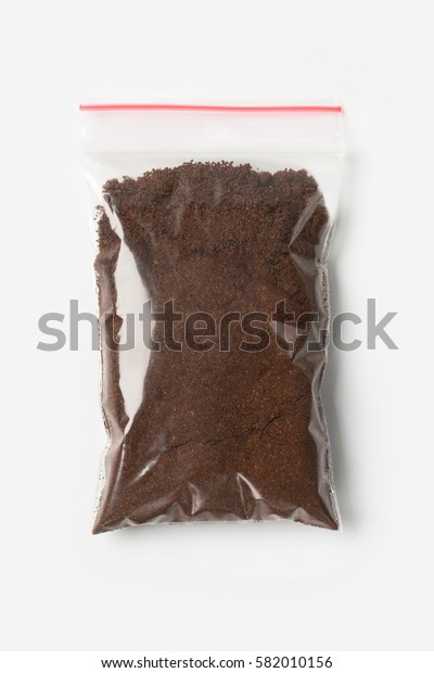 Plastic transparent zipper bag with full Brewed coffee powder isolated on white, Vacuum package mockup with red clip. Concept.