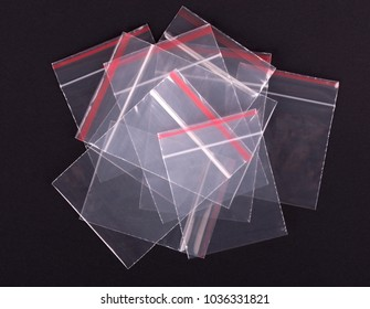 Plastic transparent zipper bag on black background. Block zip lock packaging. Empty polythene zip-lock sealed wrap. Clear pack