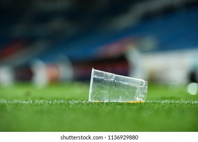 Plastic trash can on the turf on a soccer field