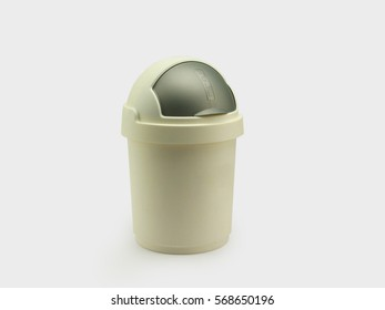 Plastic trash can with roll top cover isolated in white background