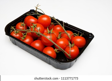 a plastic tray with some tomatoes