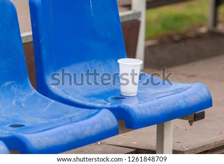 Plastic Tumbler Stands On Stadium Chair Stock Photo (Edit