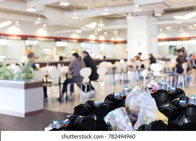 plastic waste garbage bag black bin full Lots pile of junk at front canteen food court mall department store background, pollution garbage bin pile dump trash waste