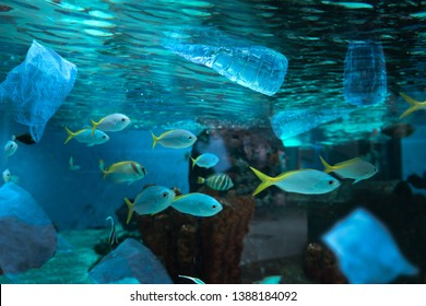 Plastic water bottle and bag floating in sea concept for environmental pollution of plastic water bottle in the ocean
