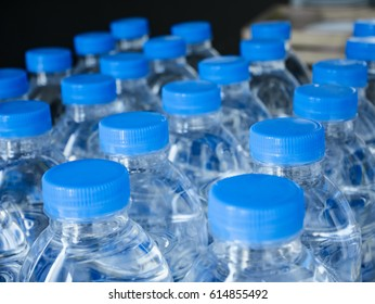 Plastic Water Bottle caps in rows Drinking Product Logistic