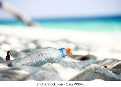 A plastic water bottle was left on the beautiful beach.