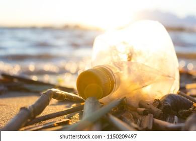 Plastic water bottles pollute ocean. bottle on the cost