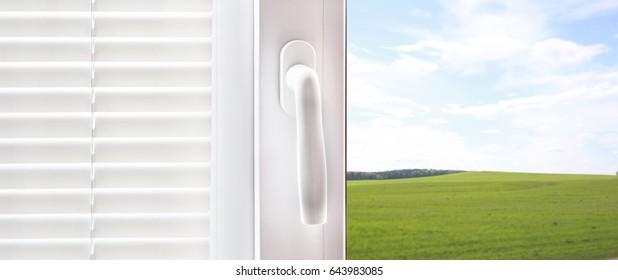 Plastic window handle, white window blinds