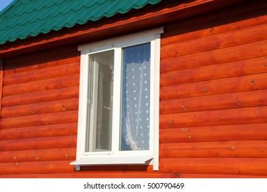Plastic window of a modern summer cottage