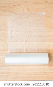 plastic wrap isolated on wood