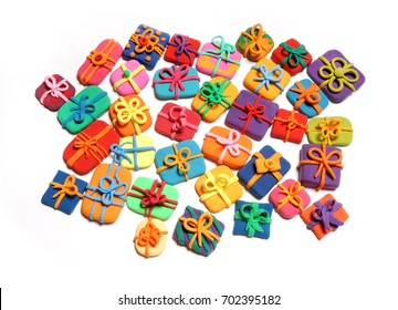 Plasticine abstraction. Boxes with gifts from plasticine