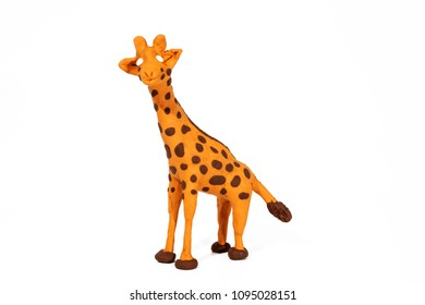 Plasticine artwork. Handmade giraffe. Abstract isolated photo.