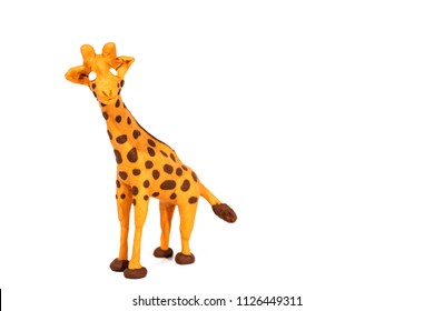 Plasticine artwork. Handmade giraffe. Abstract isolated photo.