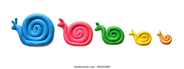 Plasticine colored snails isolated on white background