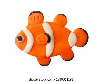 Plasticine cute orange Clownfish  isolated on a white background. Clipping path.