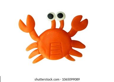 Plasticine cute orange crab isolated on a white background. Clipping path.